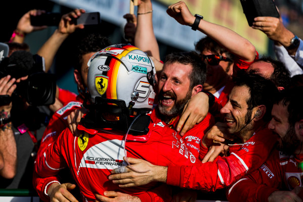 Albert Park, Melbourne, Australia. Sunday 26 March 2017. Sebastian Vettel, Ferrari, 1st Position, celebrates in Parc Ferme with his team. World Copyright: Zak Mauger/LAT Images ref: Digital Image _56I1885