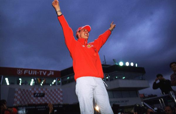 Suzuka, Japan.6-8 October 2000.Michael Schumacher (Ferrari) raises his hands in glory, after winning the Grand Prix and the drivers World Championship. World copyright - LAT Photographic