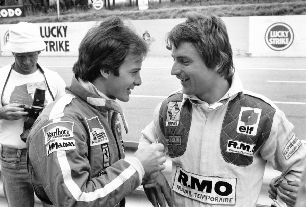 1979 South African Grand Prix. Kyalami, South Africa. 1-3 March 1979. Gilles Villeneuve (Ferrari 312T4) 1st position, chats with his good friend Rene Arnoux (Renault RS01)  retired, portrait. World Copyright - LAT Photographic. ref: SL79/93/23.