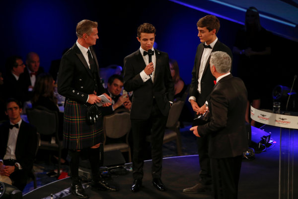 2017 Autosport Awards Grosvenor House Hotel, Park Lane, London. Sunday 3 December 2017. Derek Warwick receives an award from Lando Norris and George Russell. World Copyright: Zak Mauger/LAT Images Ref: Digital Image _l5r8201