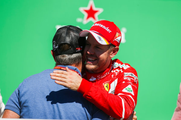 Interlagos, Sao Paulo, Brazil. Sunday 12 November 2017. Rubens Barrichello embraces Sebastian Vettel, Ferrari, 1st Position, on the podium. World Copyright: Charles Coates/LAT Images  ref: Digital Image AN7T7285