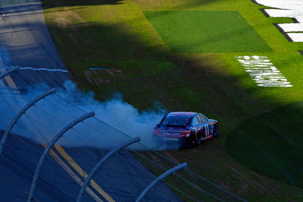 "13-21 February, 2016, Daytona Beach, Florida USA Daytona 500 winner Denny Hamlin, FedEx Express Toyota Camry celebrates by doing doughnuts in the ""ballfield"". ?2016, F. Peirce Williams LAT Photo USA"