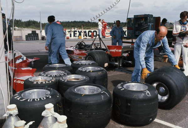 Anderstorp, Sweden. 11th - 13th June 1976. Ferrari 312 T2 cars in the paddock with their Goodyear tyres being changed, portrait.  World Copyright: LAT Photographic.  Ref: 76 SWE 17.