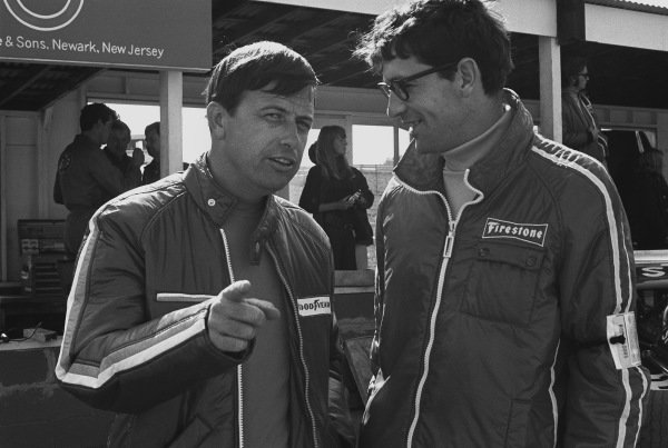 1970 United States Grand Prix. Watkins Glen, New York, USA. 2nd - 4th October 1970. Goodyear's Racing Manager Leo Mehl in conversation with a Firestone's Nigel Bennett in the paddock, portrait.  World Copyright: LAT Photographic. Ref:  3348 - 3.