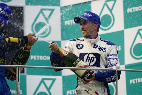 Nick Heidfeld celebrates 3rd position on the podium.