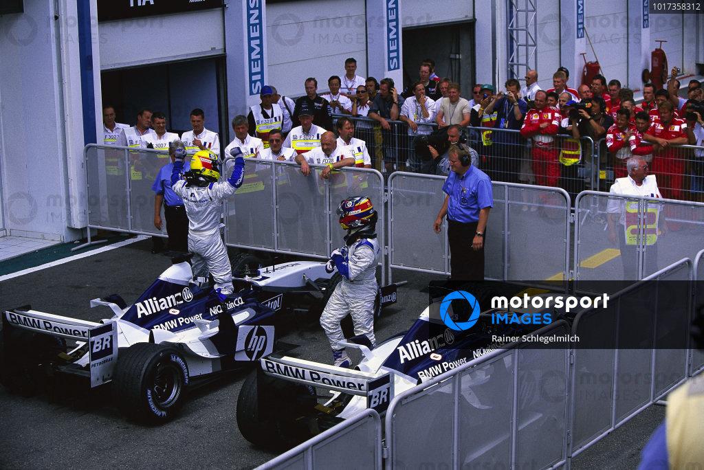 Ralf Schumacher, Williams FW25 BMW, and Juan Pablo Montoya, celebrate a second successive 1-2 after the race.