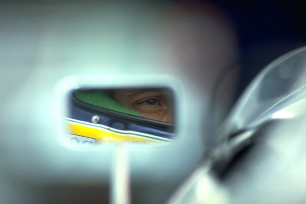 Ayrton Senna is seen in the mirror of his McLaren MP4-6 Honda.
