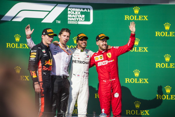 Max Verstappen, Red Bull Racing, 2nd position, Matt Deane, Chief Mechanic, Mercedes AMG, Lewis Hamilton, Mercedes AMG F1, 1st position, and Sebastian Vettel, Ferrari, 3rd position, on the podium