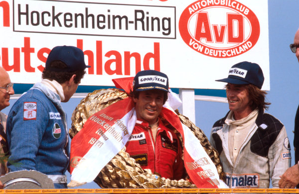 1978 German Grand Prix.Hockenheim, Germany.28-30 July 1978.Mario Andretti (Team Lotus) 1st position, Jody Scheckter (Wolf Ford) 2nd position and Jacques Laffite (Ligier Matra) 3rd position on the podium.Ref-78 GER 01.World Copyright - LAT Photographic
