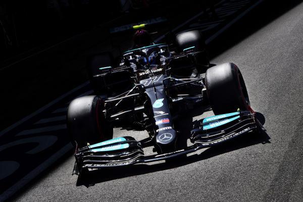 Valtteri Bottas, Mercedes W12, leaves the garage