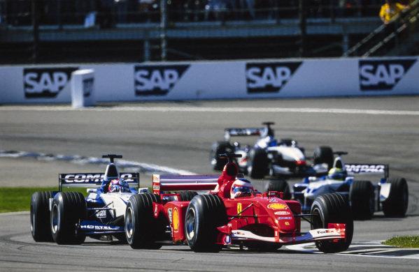 Rubens Barrichello, Ferrari F2001, leads Juan Pablo Montoya, Williams FW23 BMW, Ralf Schumacher, Williams FW23 BMW, and Mika Häkkinen, McLaren MP4-16 Mercedes.