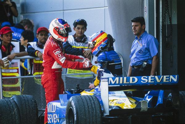 Rubens Barrichello congratulates Fernando Alonso, Renault R23, in Parc Ferme.