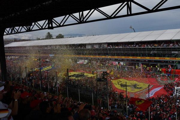 Giant ferrari flag on track after fans invade
