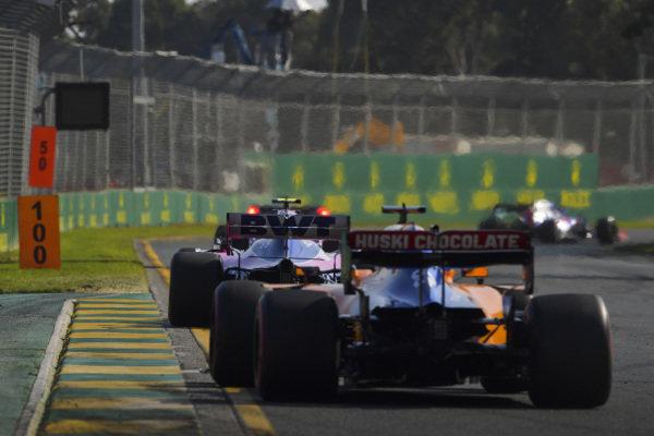 Lance Stroll, Racing Point RP19, leads Carlos Sainz Jr., McLaren MCL34