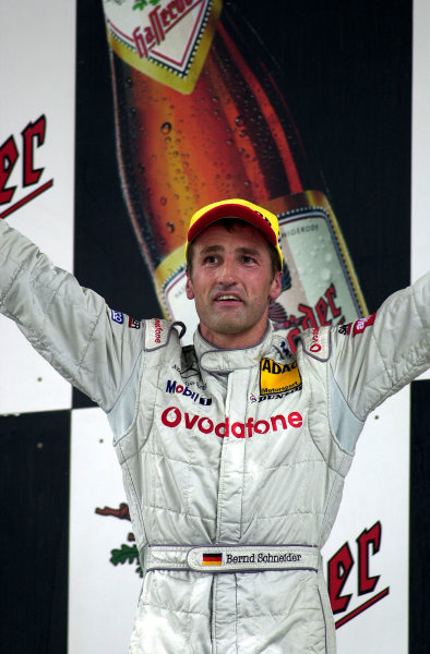 2002 DTM Championship Lausitzring, Germany. 12th - 14th July 2002.Bernd Schneider (Mercedes-Benz), 1st position on the podium.World Copyright: Andre Irlmeier/LAT Photographic