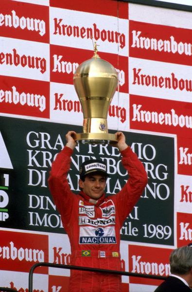 Imola, Italy.21-23 April 1989.Ayrton Senna (McLaren Honda) celebrates 1st position on the podium.Ref-89 SM 04.World Copyright - LAT Photographic
