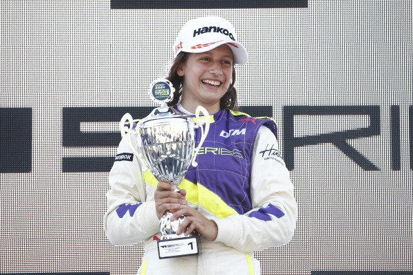 Megan Gilkes (CAN) celebrates on the podium