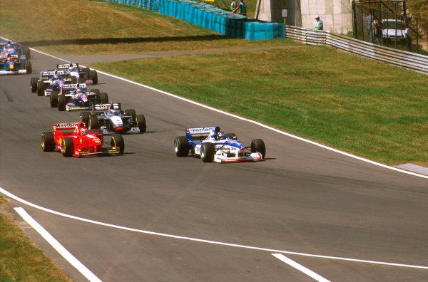 Hungaroring, Hungary.8-10 August 1997.Damon Hill (Arrows A18 Yamaha) heads into Turn 2 followed by Eddie Irvine (Ferrari F310B) and Mika Hakkinen (McLaren MP4/12 Mercedes.Ref-97 HUN 31.World  Copyright - LAT Photographic