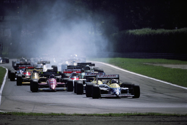 Nelson Piquet, Williams FW11B Honda, leads teammate Nigel Mansell and Gerhard Berger, Ferrari F1-87, at the start.