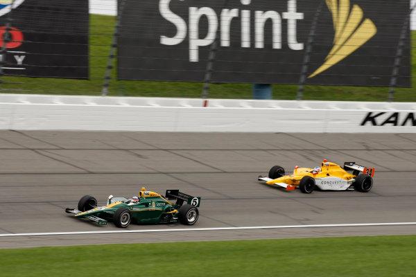 30 April - 1 May, 2010, Kansas City, Kansas, USATakuma Sato leads Bertrand Baguette.©2010 Phillip Abbott, USALAT Photographic