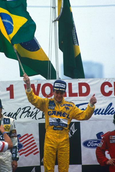 Detroit, Michigan, U.S A.19-21 June 1987.Ayrton Senna (Lotus 99T Honda) 1st position, podium, portrait.World Copyright: LAT Photographic.Ref:  Colour Transparency.