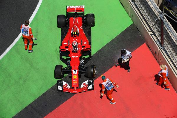 Kimi Raikkonen, Ferrari SF70H, receives assistance from marshals in an escape road.