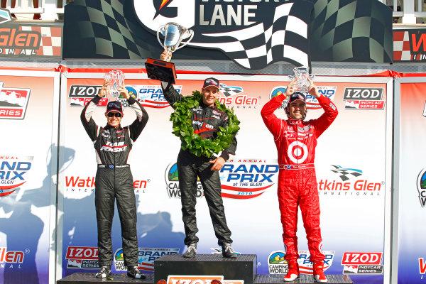 2-4 July, 2010, Watkins Glen, New York, USAWill Power celebrates in victory lane with Ryan Briscoe and Dario Franchitti.©2010, Phillip Abbott, USALAT Photographic