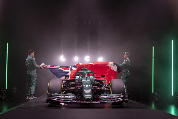 Lance Stroll, Aston Martin, and Sebastian Vettel, Aston Martin, lift the Union Jack to unveil the new Aston Martin AMR21
