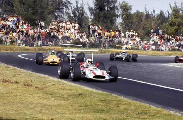 John Surtees (GBR) in a Honda RA301 and Denny Hulme (NZL) in a McLaren Cosworth M7A keep other rivals behind.