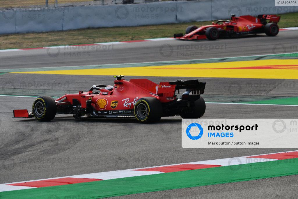 Sebastian Vettel, Ferrari SF1000, approaches as Charles Leclerc, Ferrari SF1000, spins