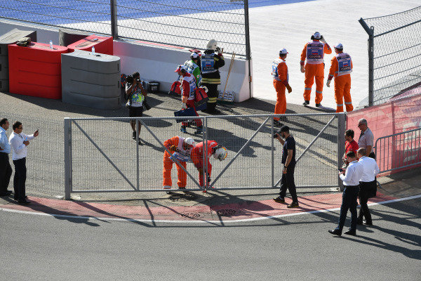 Marshals assist Sebastian Vettel, Ferrari, after he retired from the race with car trouble