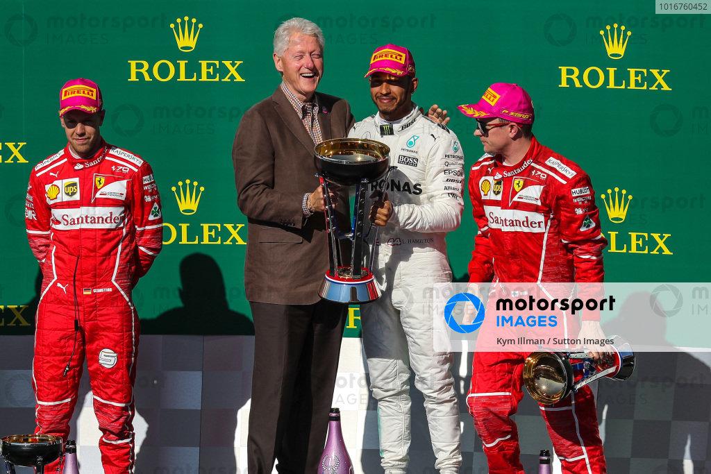 Race winner Lewis Hamilton (GBR) Mercedes AMG F1 celebrates on the podium with Bill Clinton (USA), Sebastian Vettel (GER) Ferrari, Kimi Raikkonen (FIN) Ferrari and the trophy at Formula One World Championship, Rd17, United States Grand Prix, Race, Circuit of the Americas, Austin, Texas, USA, Sunday 22 October 2017. BEST IMAGE