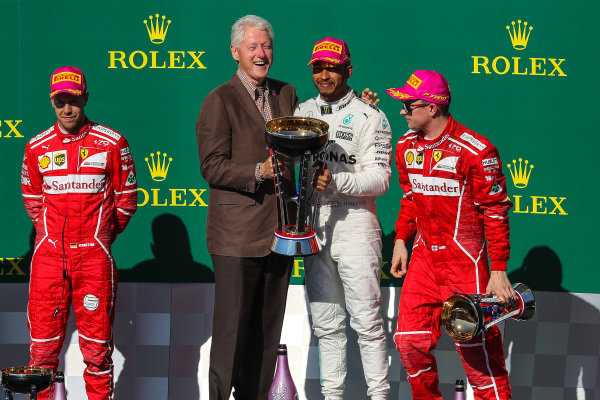 Race winner Lewis Hamilton (GBR) Mercedes AMG F1 celebrates on the podium with Bill Clinton (USA), Sebastian Vettel (GER) Ferrari, Kimi Raikkonen (FIN) Ferrari and the trophy at Formula One World Championship, Rd17, United States Grand Prix, Race, Circuit of the Americas, Austin, Texas, USA, Sunday 22 October 2017.