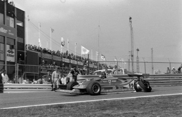 Gilles Villeneuve, Ferrari 312T4, with a punctured right-rear tyre.
