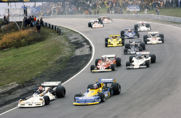 Vittorio Brambilla, Surtees TS19 Ford leads Ian Scheckter, March 771 Ford, Gilles Villeneuve, Ferrari 312T2, 12th position and Patrick Tambay, Ensign N177 Ford, 5th position.