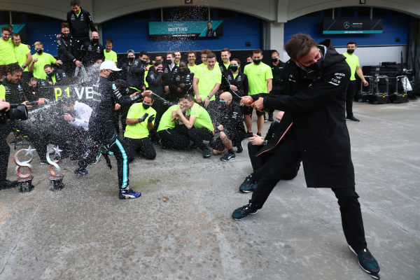 Toto Wolff, Team Principal and CEO, Mercedes AMG, sprays Champagne at Valtteri Bottas, Mercedes, 1st position, and the Mercedes team