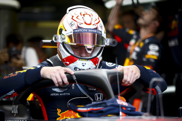 Max Verstappen, Red Bull Racing, settles into his seat