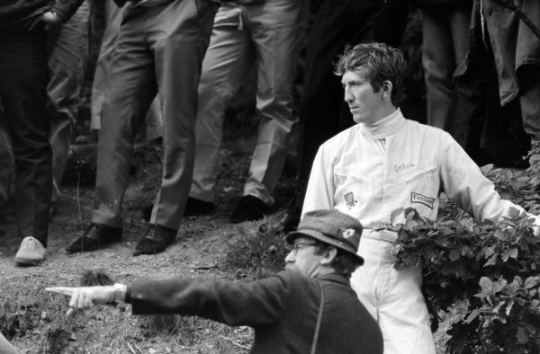 Jochen Rindt at the side of the track.