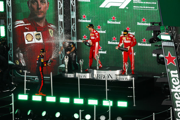 Max Verstappen, Red Bull Racing, 1st position, Sebastian Vettel, Ferrari, 2nd position, and Kimi Raikkonen, Ferrari, 3rd position, spray Champagne on the podium