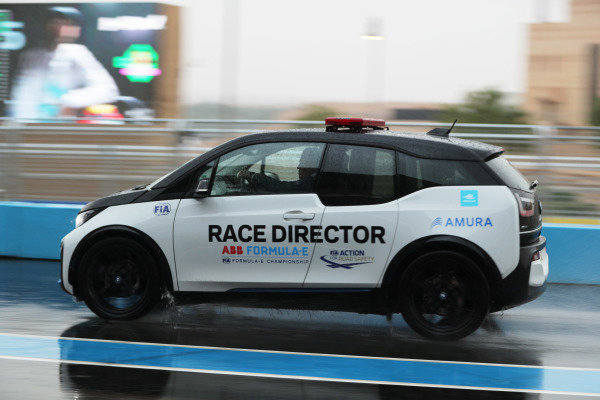 The Race Director's car on a wet track