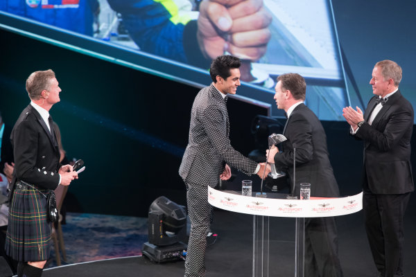 2017 Autosport Awards Grosvenor House Hotel, Park Lane, London. Sunday 3 December 2017. Enaam Ahmed on stage with Christian Horner and Martin Brundle to accept the British Club Driver of the Year Award. World Copyright: Joe Portlock/LAT Images  ref: Digital Image _R3I5795