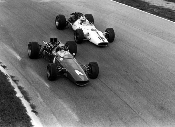 1967 Italian Grand Prix Monza, Italy. 10 September 1967 Bruce McLaren, McLaren M5A-BRM, retired, leads John Surtees, Honda RA300, 1st position, action World Copyright: LAT PhotographicRef: 660B #32
