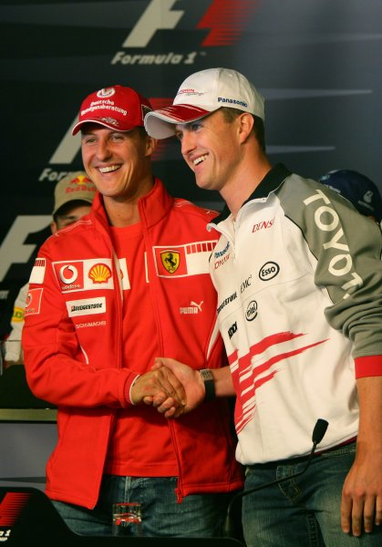 2006 European Grand Prix - Thursday Preview, Nurburgring, Germany. Michael Schumacher, Ferrari 248 F1 and Ralf Schumacher, Toyota TF106 shake hands in the press conference. Portrait. 4th May 2006  World Copyright: Steve Etherington/LAT Photographic   ref: 48mb Hi Res Digital Image Only
