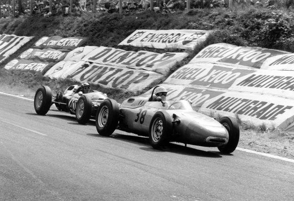 1962 French Grand Prix Rouen-les-Essarts, France. 6-8 July 1962 Carel Godin de Beaufort (Porsche 718) leads Jo Siffert (Lotus 24-BRM).World Copyright: LAT PhotographicRef: Autosport b&w print