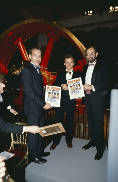 1988 Autosport Awards. Science Museum, London, Great Britain. 5 January 1989. Andy Wallace and Jan Lammers receive a special award from Peter Foubister, portrait. World Copyright: LAT Photographic Ref: 35mm transparency