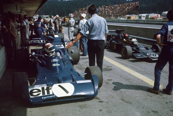 1972 Austrian Grand Prix.  Osterreichring, Zeltweg, Austria. 11-13th August 1972.  Jackie Stewart, Tyrrell 005 Ford, is held in the pits as Emerson Fittipaldi, Lotus 72D Ford, goes past and François Cevert, Tyrrell 002 Ford, prepares in the backgound.  Ref: 72AUT07. World Copyright: LAT Photographic