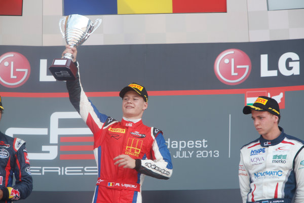2013 GP3 Series. Round 5.  Hungaroring, Budapest, Hungary. 28th July 2013.  Sunday Race. Robert Visoiu (ROU, MW Arden) celebrates his victory on the podium.  World Copyright: Alastair Staley/GP3 Media Service  Ref: _R6T6123