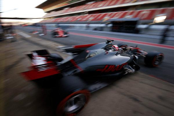 Circuit de Barcelona Catalunya, Barcelona, Spain. Tuesday 07 March 2017. Kevin Magnussen, Haas VF-17 Ferrari, leaves the garage as Sebastian Vettel, Ferrari SF70H, returns. World Copyright: Sam Bloxham/LAT Images ref: Digital Image _SLB3727