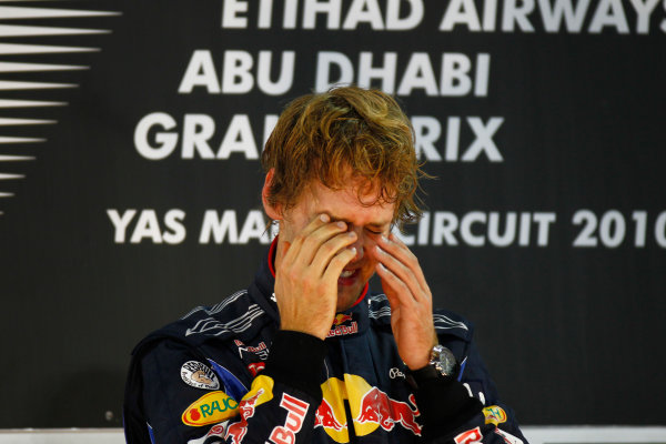 Yas Marina Circuit, Abu Dhabi, United Arab Emirates 14th November 2010. New world champion Sebastian Vettel, Red Bull Racing RB6 Renault, 1st position, on the podium. Portrait. Podium.  World Copyright: Glenn Dunbar/LAT Photographic  ref: Digital Image _G7C9782