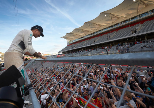 Circuit of the Americas, Austin, Texas, United States of America. Sunday 2 November 2014. Lewis Hamilton, Mercedes AMG celebrates with the fans after winning the race. World Copyright: Steve Etherington/LAT Photographic. ref: Digital Image SNE10585
